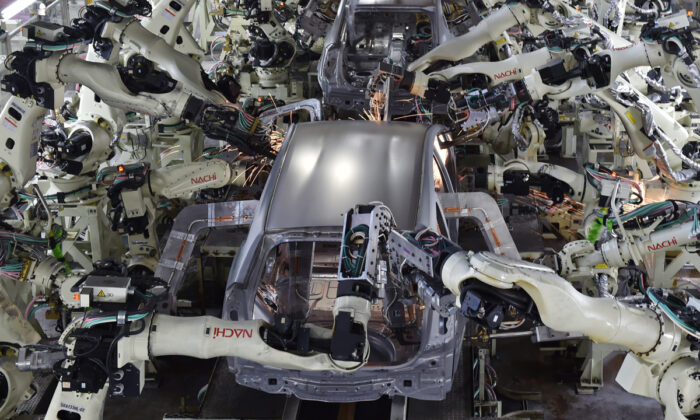 A welding workshop uses automated welding machine robots that assemble automobile bodies at Toyota Motor's Tsutsumi plant in Toyota, Aichi prefecture, on Dec. 4, 2014. The supposed goal behind universal basic income is to help displaced workers who can't keep up with labor market developments, like automation and immigration, or otherwise disenfranchised people.  Kazuhiro Nogi/AFP via Getty Images