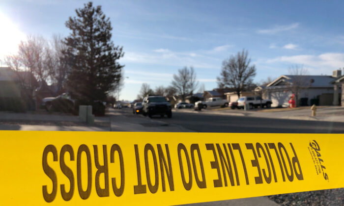 Police have a residential street cordoned off as detectives investigate the deaths of four people found Christmas Day inside a home in Rio Rancho, N.M., on Dec. 26, 2019. (Susan Montoya Bryan/AP Photo)