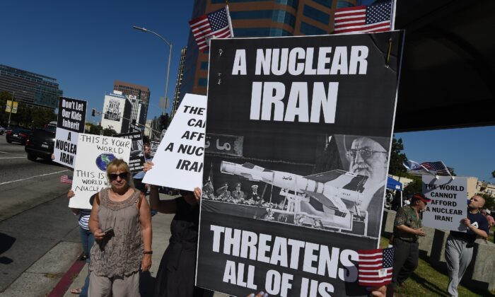 Members of the 'Stand With Us' group hold a rally calling for the rejection of the proposed Iran nuclear deal outside the Federal Building in Los Angeles on July 26, 2015. (Mark Ralston/AFP via Getty Images)
