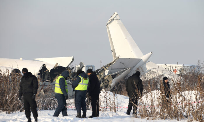 Emergency and security personnel are seen at the site of a plane crash near Almaty, Kazakhstan, on Dec. 27, 2019. (Pavel Mikheyev/Reuters)
