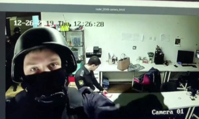 A still image of a screen shows a CCTV footage at the headquarters of Russian opposition politician Alexei Navalny's Anti-Corruption Foundation during a police raid in Moscow, Russia December 26, 2019. Anti-Corruption Foundation (FBK)/Handout via REUTERS TV  ATTENTION EDITORS - THIS IMAGE WAS PROVIDED BY A THIRD PARTY. MANDATORY CREDIT. NO RESALES. NO ARCHIVES.