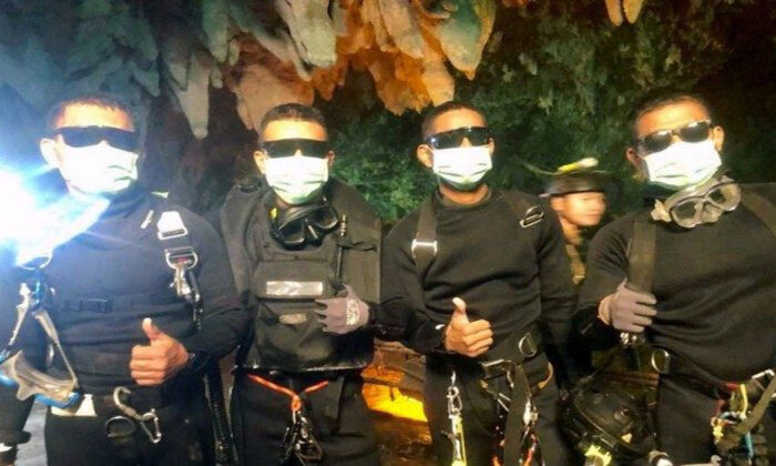 Four Thai Navy Seals are seen after leaving the cave during the rescue mission in Chiang Rai Province, Thailand, on July 10, 2018. (Thai Navy Seal/via Reuters)