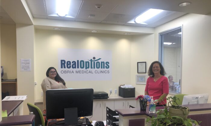 Staff members at RealOptions in Central San Jose. (Nathan Su/The Epoch Times)