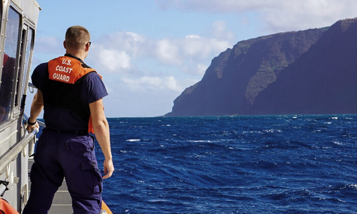 Coast Guard Cutter William Hart moves toward the Na Pali Coast on the Hawaiian island of Kauai on Dec. 27, 2019, the day after a tour helicopter disappeared with seven people aboard. (MK3 Forest Herring/U.S. Coast Guard via AP)