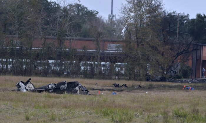 A view of the burnt wreckage of a plane crash near Feu Follet Road and Verot School Road in Lafayette, Louisiana, on Dec. 28, 2019. (Scott Clause/The Lafayette Advertiser via AP)