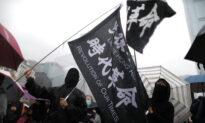 More Than 1,000 Gather for Rain-Soaked Hong Kong Rally