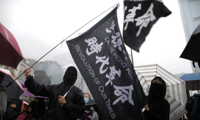 Anti-government demonstrators take part in a protest in Edinburgh Place in Hong Kong, China, Dec. 29, 2019. (Reuters/Lucy Nicholson)