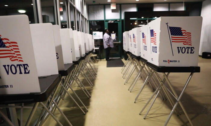 Voting booths are setup at the Yuengling Center on the campus of University of South Florida as workers prepare to open the doors to early voters in Tampa, Fla., on Oct. 22, 2018.  (Joe Raedle/Getty Images)