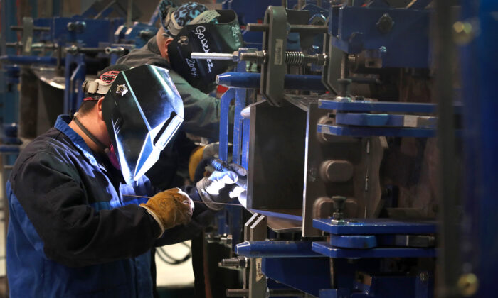 "Workers at LB Steel LLC manufacture wheel assemblies known as ""bogies"" to be used on the new Amtrak Acela trains which are being built in partnership with Alstom in Harvey, Ill., on Dec. 4, 2019.  (Scott Olson/Getty Images)"