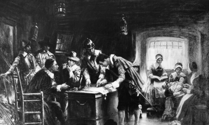 '9th November 1620, Signing the Mayflower Compact' by Edward Percy Moran (1862-1935). Aboard ship the pilgrims are signing an agreement for temporary government of the colony by the will of the majority. (Three Lions/Getty Images)