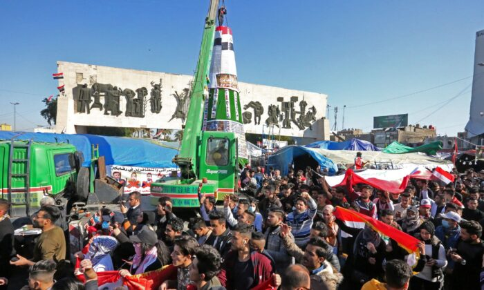 Iraqi anti-government protesters erect a Christmas tree in the capital Baghdad's central Tahrir Square on Dec. 24, 2019. (SABAH ARAR/AFP via Getty Images)