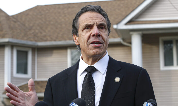New York Governor Andrew Cuomo speaks to the media outside the home of rabbi Chaim Rottenbergin in Monsey, N.Y., on Dec. 29, 2019 after a machete attack that took place earlier outside the rabbi's home during the Jewish festival of Hanukkah in Monsey, N.Y. (Kena Betancur/AFP via Getty Images)