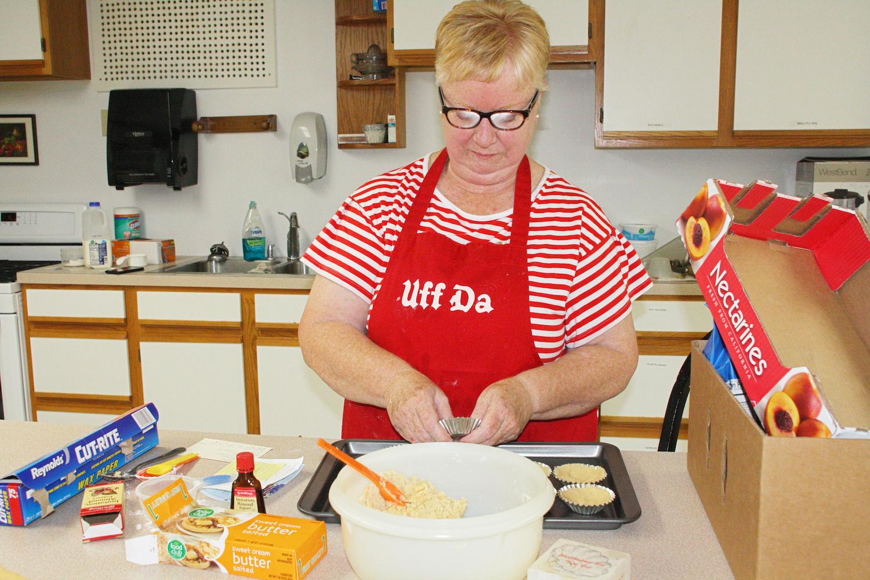 woman makes sandbakkel cookies