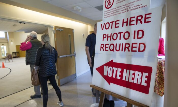 A sign reminds voters they need photo ID to vote on Election Day at a polling station at Hillsboro Presbyterian Church, in Nashville, Tennessee, on  Nov. 6, 2018. (Drew Angerer/Getty Images)