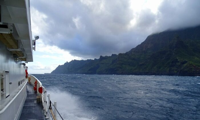 Coast Guard Cutter William Hart moves toward the Na Pali Coast on the Hawaiian island of Kauai on Dec. 27, 2019, the day after a tour helicopter disappeared with seven people aboard.(Lt. j.g. Daniel Winter/U.S. Coast Guard via AP)