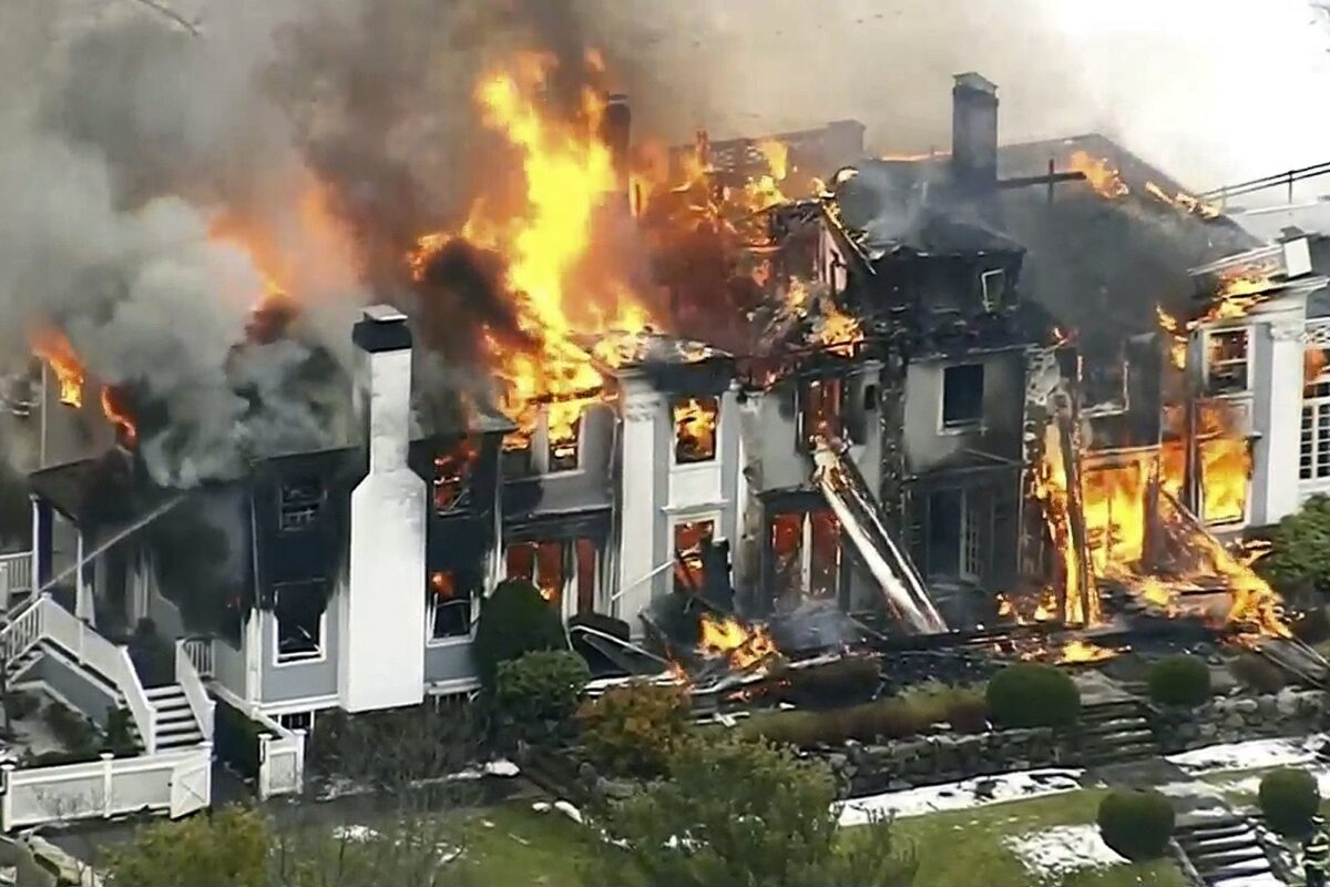 A mansion ablaze,