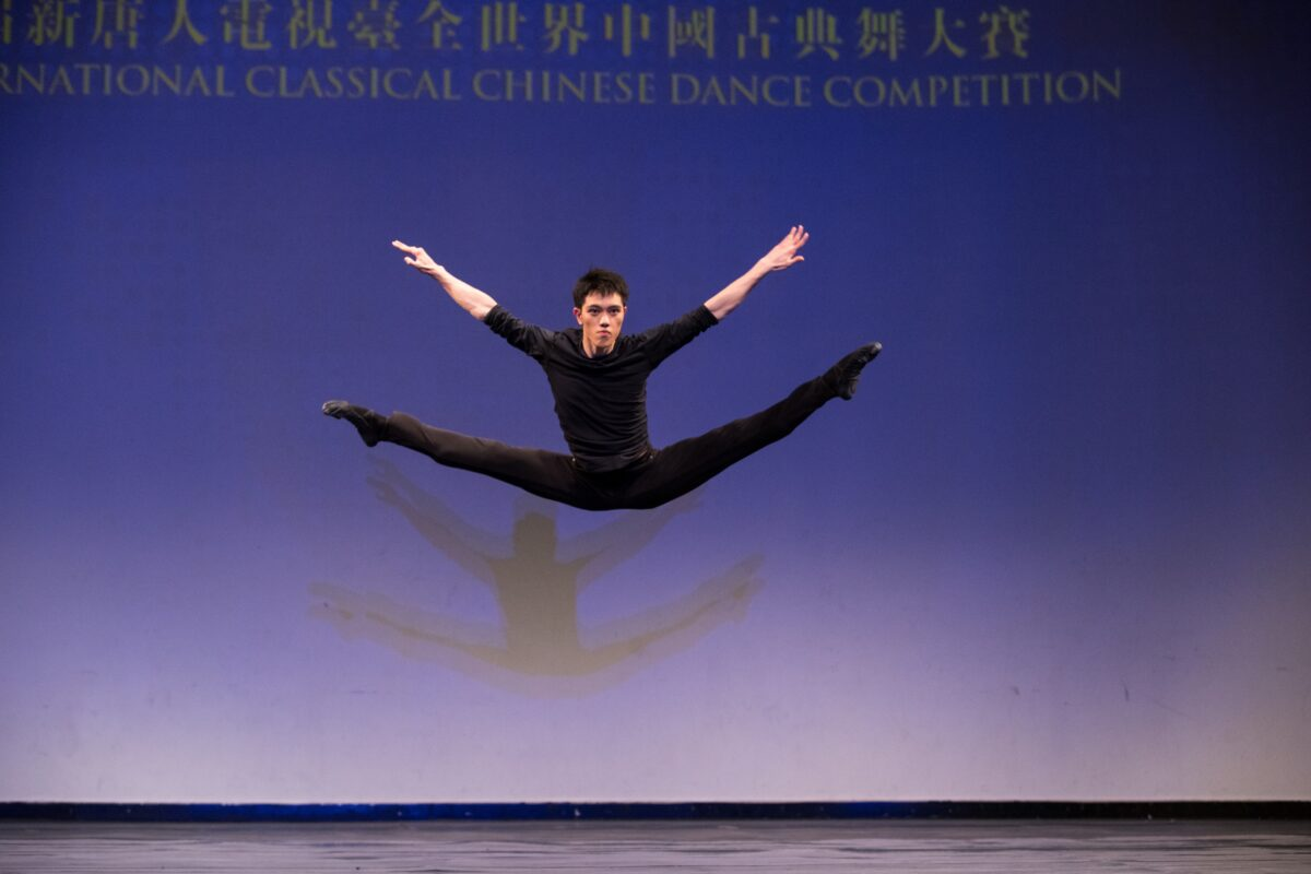 Monty Mou in a spread eagle leap, in the 2018 NTD International Classical Dance Competition