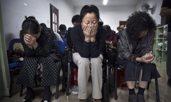 Chinese Christians pray during a service at an underground independent Protestant Church in Beijing, China on Oct. 12, 2019. China, an officially atheist country, places a number of restrictions on Christians and allows legal practice of the faith only at state-approved churches. (Kevin Frayer/Getty Images)