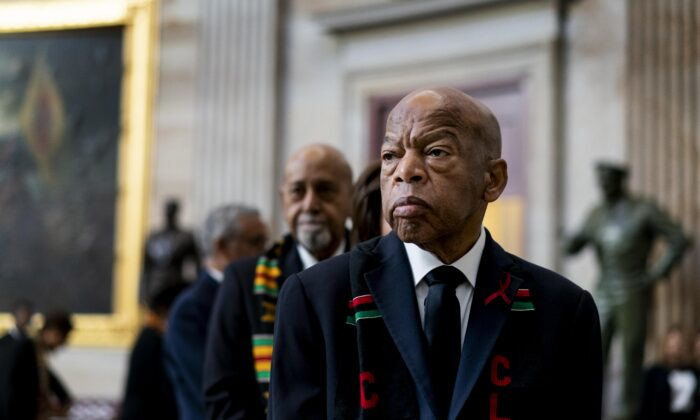 Civil Rights activist Congressman John Lewis (D-GA) prepares to pay his respects to U.S. Rep. Elijah Cummings (D-MD) who lies in state within Statuary Hall during a memorial ceremony on Capitol Hill in Washington on Oct. 24, 2019. (Melina Mara-Pool/Getty Images)
