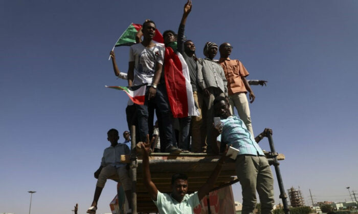 People gather as they celebrate first anniversary of mass protests that led to the ouster of former president and longtime autocrat Omar al-Bashir in Khartoum, Sudan, Nov. 19, 2019. (AP Photo)