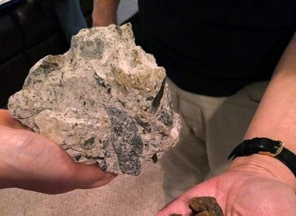 Nuggets of the rust-coloured mineralpyrrhotite (R) and a chunk of concrete containing the mineral that's been removed from a crumbling basement (L) in a file photo. (The Canadian Press/AP-Susan Haigh)