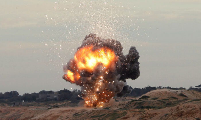 A MANPAD (Man-Portable Air Defiance Systems) missile is detonated along the shore facing the Firing Range, east of the Libyan capital Tripoli, on Dec. 11, 2011. (Ismail Zitouny/Reuters)