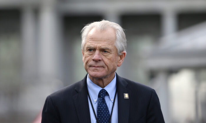 White House trade adviser Peter Navarro listens to a news conference about a presidential executive order relating to military veterans outside of the West Wing of the White House in Washington on March 4, 2019. (Leah Millis/Reuters)