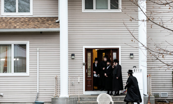 People gather at Rabbi Chaim Rottenberg's residence in Monsey, New York, on Dec. 29, 2019. (Jeenah Moon/Reuters)