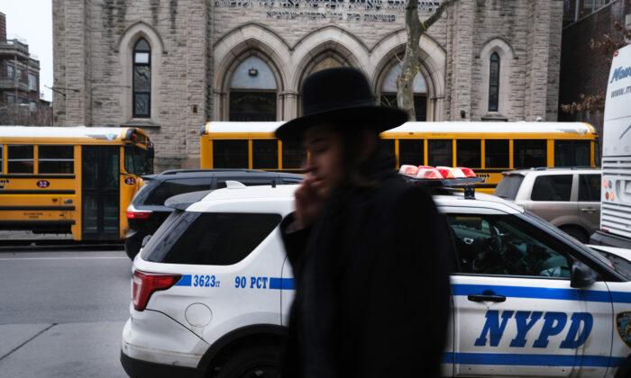A member of an Orthodox Jewish community walks through a Brooklyn neighborhood on Dec. 29, 2019 in New York City. (Spencer Platt/Getty Images)