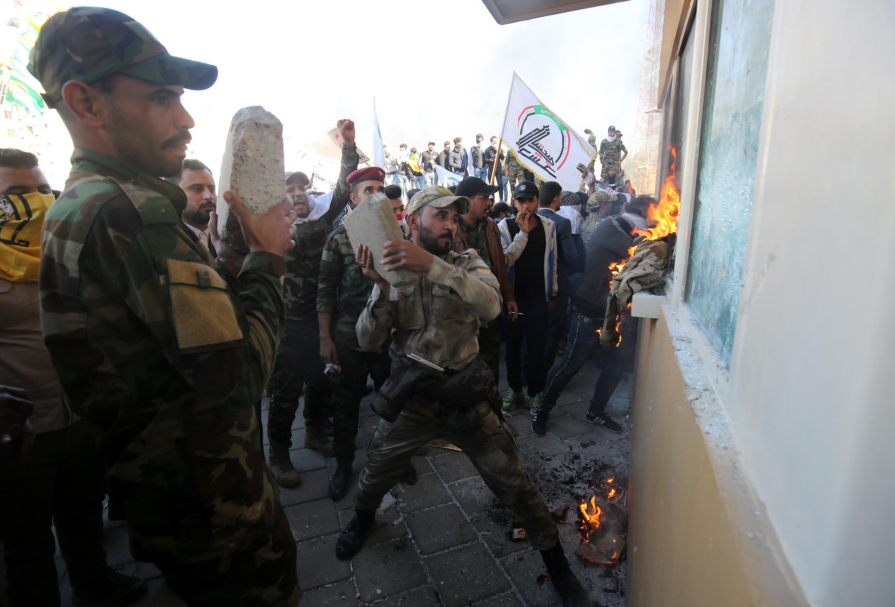 Members the Hashed al-Shaabi smash embassay