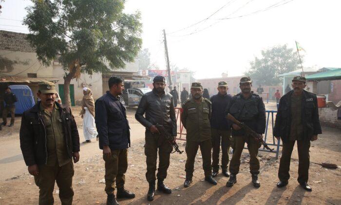Pakistani police officers stand guard outside Multan jail after a court's decision for a professor facing blasphemy case, in Multan, Pakistan, on Dec. 21, 2019. (AP Photo/Asim Tanveer)