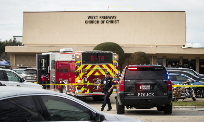 Police and fire department surround the scene of a shooting at West Freeway Church of Christ in White Settlement, Texas on Sunday, Dec. 29, 2019. (Yffy Yossifor/Star-Telegram via AP)