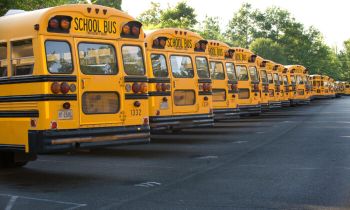File photo showing school buses in a parking lot in Fairfax, Va., on June 24, 2008. (Paul J. Richards/AFP via Getty Images)