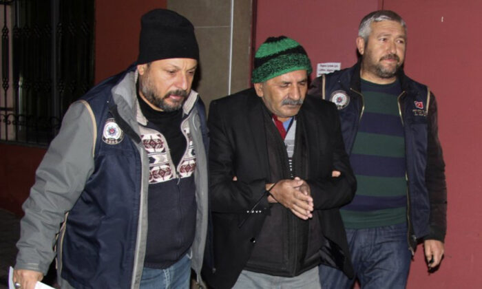 Security members detained a man in central Anatolian city of Kayseri, Turkey, early Dec. 30, 2019. (DHA via AP)