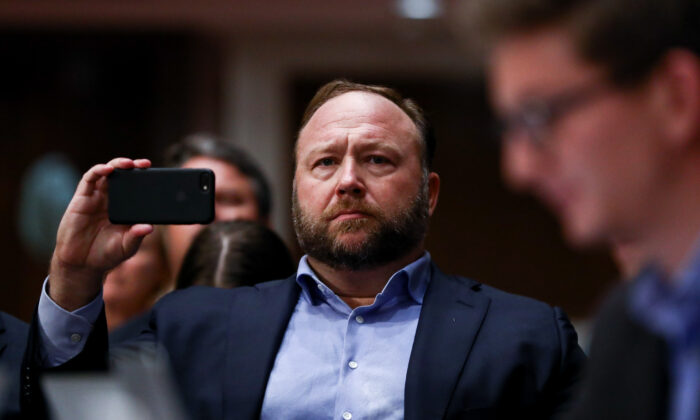 InfoWars founder Alex Jones takes photographs at a hearing to examine foreign influence operations' use of social media platforms before the Intelligence Committee at the Capitol in Washington on Sept. 5, 2018. (Samira Bouaou/The Epoch Times)