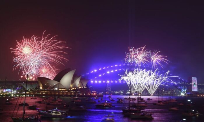 Fireworks are seen from Mrs. Macquarie's Chair during New Year's Eve celebrations in Sydney, Tuesday, Dec. 31, 2019. (Mick Tsikas/AAP Image via AP)