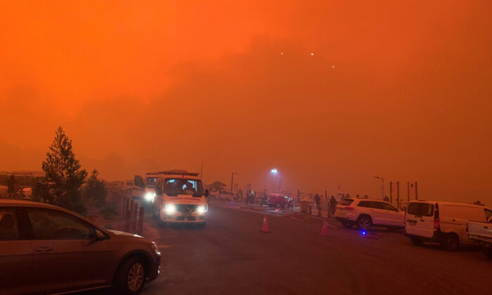 The sky glows red as bushfires continue to rage in Mallacoota, Victoria, Australia, on Dec. 31, 2019. (Melbourne/via Reuters)