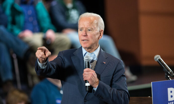 Democratic presidential candidate, former Vice President Joe Biden points to a member of the crowd who wanted to ask a question during a campaign Town Hall in Derry, N.H., on Dec. 30, 2019. (Scott Eisen/Getty Images)