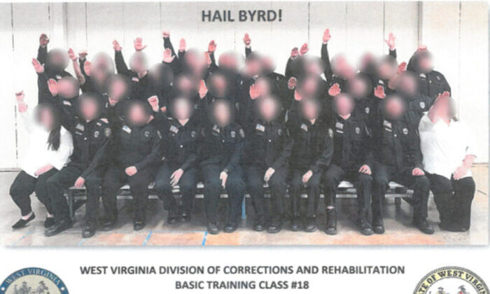 "The class photo showing members of the basic training class with their hands outstretched in what appears to be a Nazi salute. It's captioned ""Hail Byrd"" in a reference to an instructor named Byrd. 