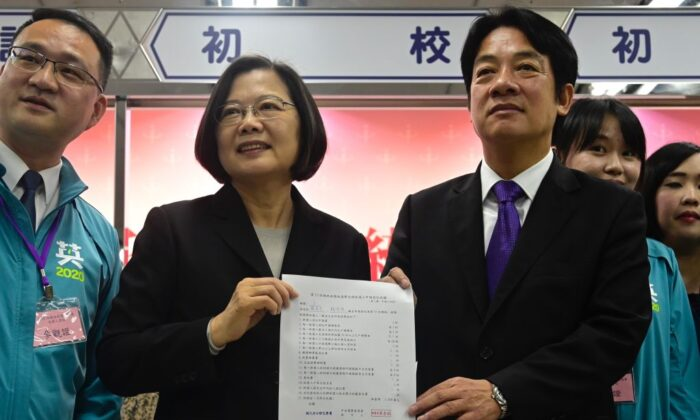 Taiwan's President Tsai Ing-wen (2nd L) and former premier William Lai (R) display a certificate after registering as presidential and vice-presidential candidates for the upcoming election at the Central Elections Committee in Taipei on Nov. 19, 2019. (Sam Yeh/AFP via Getty Images)