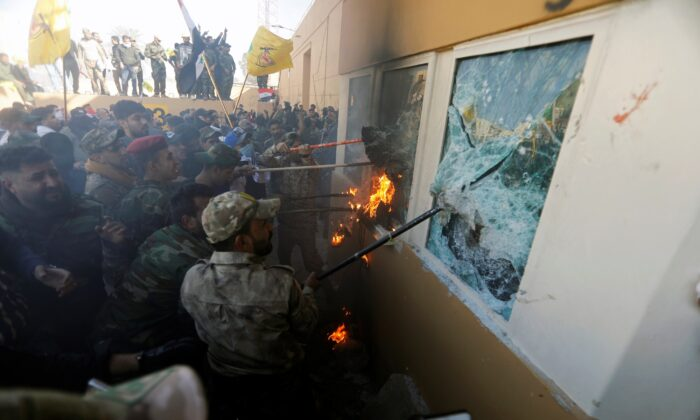Protesters and militia fighters attack a reception room of the U.S. Embassy in Baghdad, Iraq, on Dec. 31, 2019. (Khalid al-Mousily/Reuters)