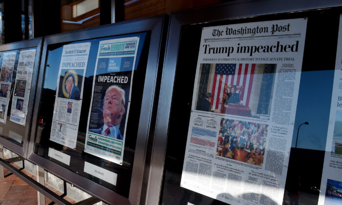 Newspaper front pages are on display at the Newseum in Washington on Dec. 19, 2019.  Olivier Douliery/AFP via Getty Images