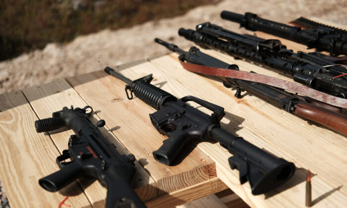 "Rifles are displayed on a table at a shooting range during the ""Rod of Iron Freedom Festival"" on  Oct. 12, 2019 in Greeley, Pennsylvania. (Spencer Platt/Getty Images)"