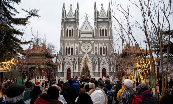 Worshippers wait outside the Xishiku Cathedral to attend a Christmas eve mass in Beijing on Dec. 24, 2019. (Noel Celsis/AFP via Getty Images)