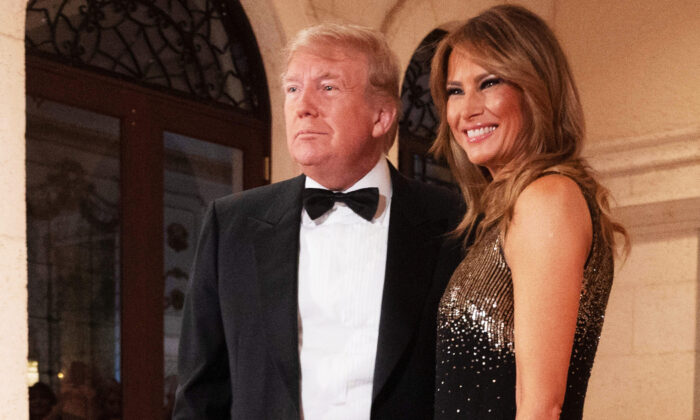 U.S. President Donald Trump and First Lady Melania Trump speak to the press outside the grand ballroom as they arrive for a New Year's celebration at Mar-a-Lago in Palm Beach, Fla., on Dec. 31, 2019.