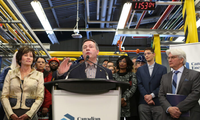 Alberta Premier Jason Kenney (C) announces the launch of the Canadian Energy Centre (CEC) as Energy Minister Sonya Savage and CEC managing director and CEO Tom Olsen look on at a press conference in Calgary on Dec. 11, 2019. (The Canadian Press/Greg Fulmes)