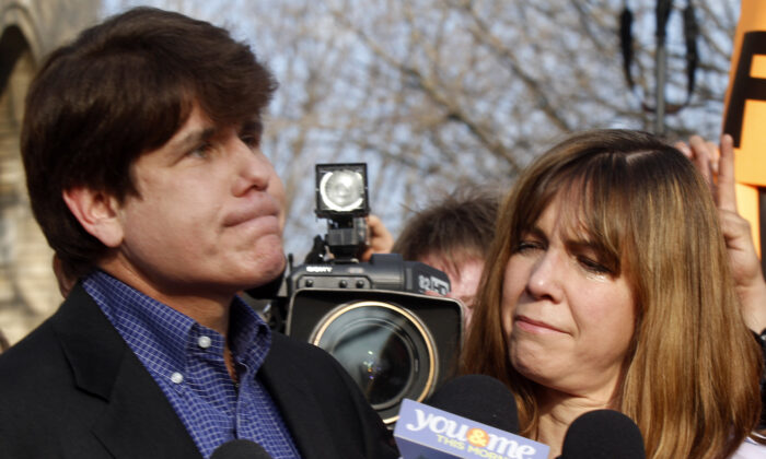 Patti Blagojevich (R), wife of disgraced former Illinois Governor Rod Blagojevich, looks at him while he pauses  at a news conference outside his home in Chicago on March 14, 2012. (Frank Polich/Getty Images)