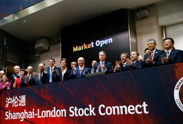 Britain's then-Chancellor of the Exchequer Philip Hammond (C) and Chinese Vice-Premier Hu Chunhua (C-R) applaud the launch of a stock link between the Shanghai and London stock exchange in London on June 17, 2019.