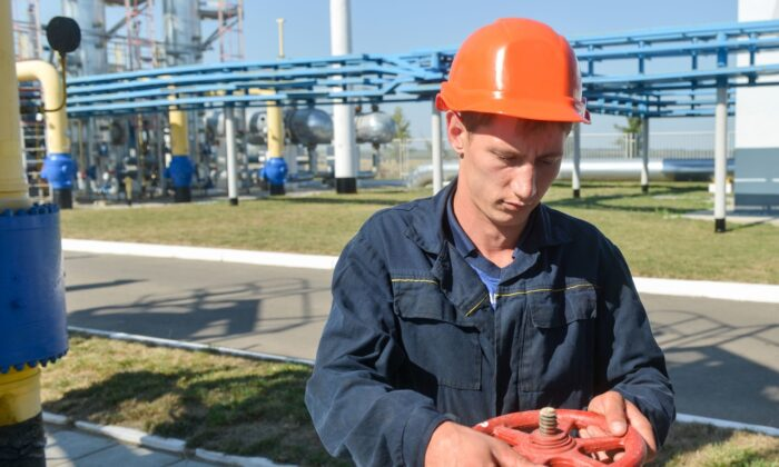 An employee works at a compressor station of Ukraine's Naftogaz national oil and gas company near the northeastern Ukrainian city of Kharkiv on August 5, 2014. (SERGEY BOBOK/AFP via Getty Images)