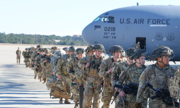 U.S. Army Paratroopers of the 82nd Airborne Division, deploy from Pope Army Airfield, North Carolina, heading to the U.S. Central Command area in response to events in Iraq, on Jan. 1, 2020. (Capt. Robyn Haake/U.S. Army/AFP via Getty Images)